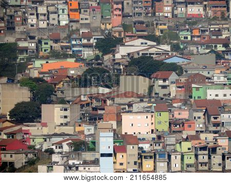 Many simple houses over the hills in Brazil
