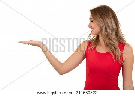 Woman pointing at sign. Young beautiful sexy woman showing copy space on empty blank sign or gift card
