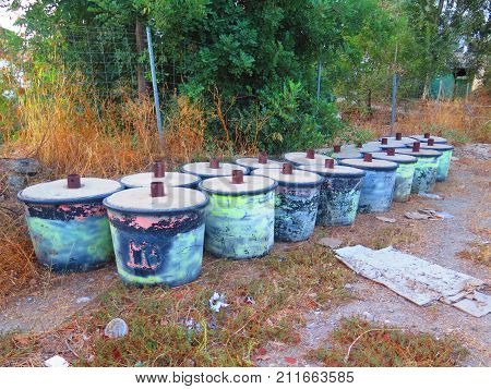 Discarded concrete filled containers used for holding roof support at village festivals in Andalusia