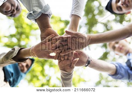 Group of diverse youth with teamwork joined hands