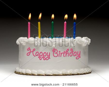 White birthday cake profile on gradient background with five colorful lit candles and