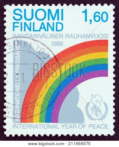 FINLAND - CIRCA 1986: A stamp printed in Finland issued for the International Peace Year shows Cloud, Rainbow and Emblem, circa 1986.