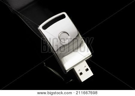 Usb Metal Flash Drive On Black Background. Silver Color Memory Stick