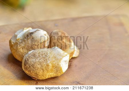 Straw Mushroom On Table With Warm White Light