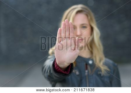 Young Woman Making A Halt Gesture