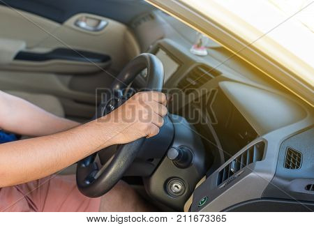 Hands man holding steering wheel and on automatic gear shift ,Driving a car