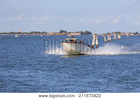 VENICE ITALY - SEPTEMBER 21 2017: Venetian Lagoon sea view and motorboat. Motorboats are the fastest way of transportation between the islands of Venice