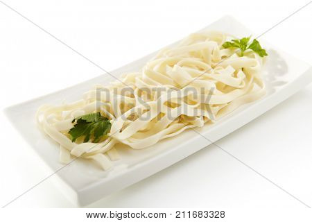 Asian menu. Wheat noodles - udon, with parsley leaves