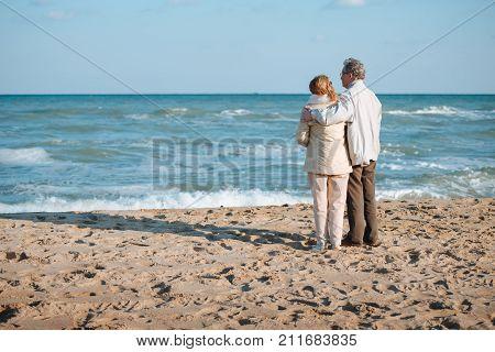 Senior Couple Hugging On Seashore