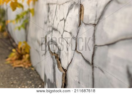 cracks and chips on the ruined foundation of the old building structure