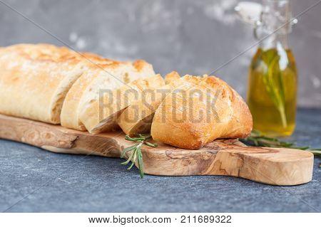 Italian ciabatta and traditional Italian ingredients on a wooden board