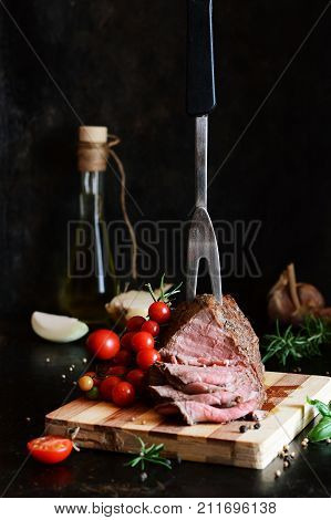 Baked beef in spices. Roast beef. The medium rea. Dinner.