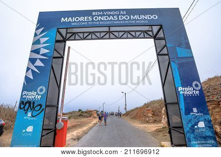 Nazare, Portugal - August 15, 2017: Gate of entrance Praia do Norte in Nazare, one of the most impressive surf sites in world. North Beach is famous for huge waves that can reach 30 meters in height.