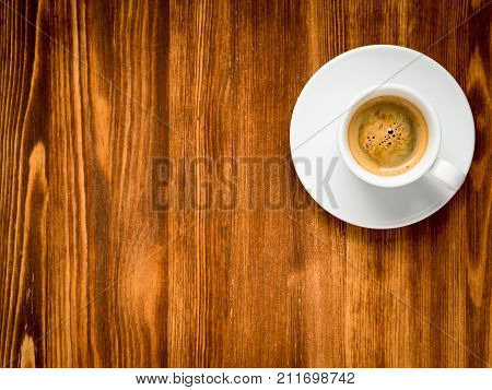 White Cup Of Frothy Coffee On Brown Dark Wooden Background