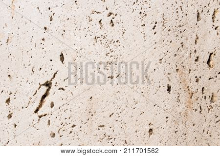 Lightened slices marble onyx. Horizontal image. Warm colors. Beautiful close up background. Gray onyx marble texture. Ideal for sites, banners, brochures, design