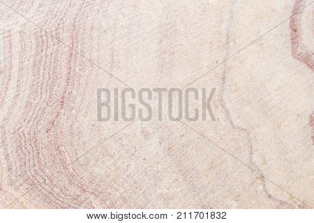 Lightened slices marble onyx. Horizontal image. Warm colors. Beautiful close up background. Pink onyx marbletexture. Ideal for sites, banners, brochures, design