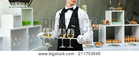 Midsection Of Professional Waiter In Uniform Serving Wine During Buffet Catering Party, Festive Even