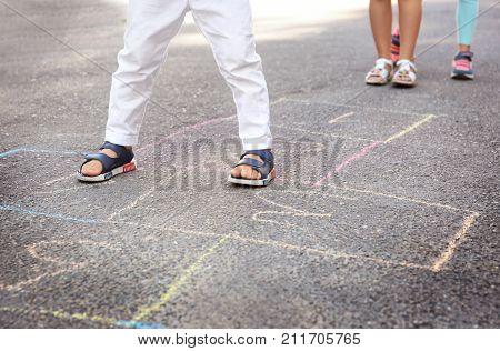 Children playing hopscotch outdoors