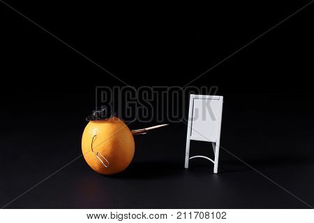 It looks like a lemon is giving a presentation and coaching