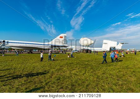 Zhukovsky, Russia - July 24. 2017. The people against the background of airplane m-4 Atlant with locator and tu144 at the international aerospace show MAKS 2017
