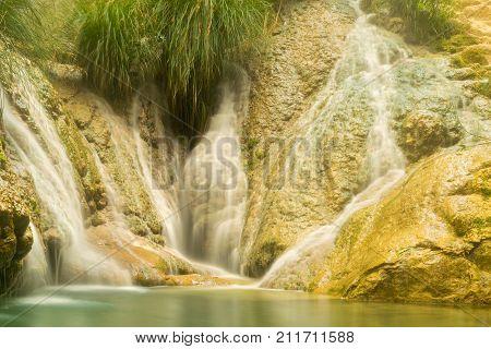 Beautiful famous waterfalls of Polilimnio in Greece.