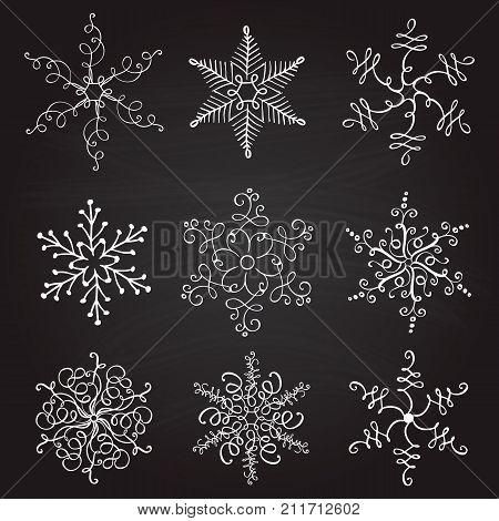 set of nine vintage vector illustration christmas snowflakes on chalkboard background. flourish calligraphic handmade.