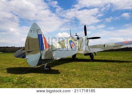 Pilot Sits In Cockpit Of Supermarine Spitfire British Fighter Aircraft