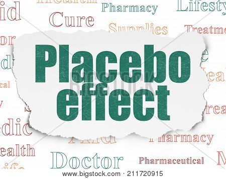 Healthcare concept: Painted green text Placebo Effect on Torn Paper background with  Tag Cloud