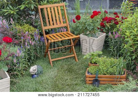 Chair and beds in a garden. Gardening