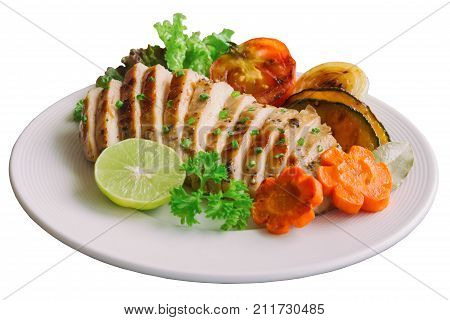 White isolate background with clipping paths sliced chicken breast steak on white plate with grilled vegetable so delicious healthy and goodness food lunch or dinner. Homemade chicken breast barbecue. Chicken steak ready to served.