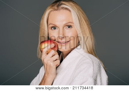 Middle Aged Woman With Apple