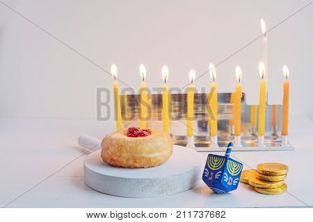 The Symbols of Hanukkah - nine-branched mehorah Hanukiah , sufganiyot, chocolate coins and sevivon