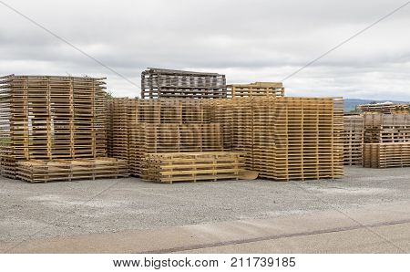 outdoor scenery showing lots of stacked wooden pallets