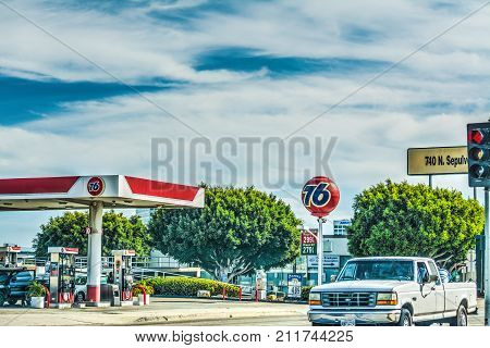 Los Angeles CA USA - October 26 2016: Car passing by a 76 gas station N Sepulveda boulevard