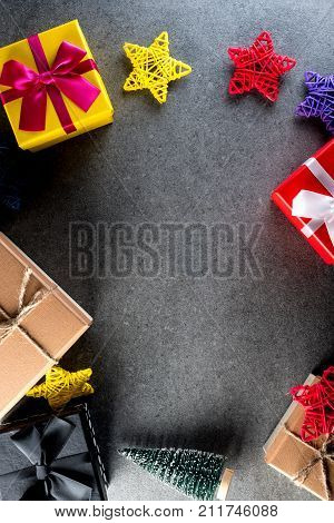 Christmas gift boxes collection with pine tree for mock up template design. Dark background. Flat lay.