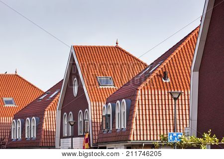 Modern red tiled roofs in residential district Fascinatio in Capelle aan den IJssel in the Netherlands