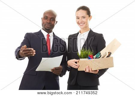 Portrait of male employer and female employee holding box with personal belongings