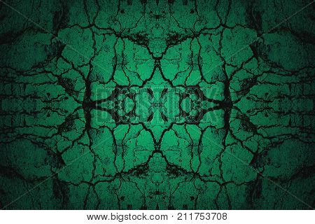 Dark green mirror image old cracked wall background with spotlight