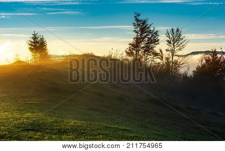 Foggy Sunrise In Mountainous Countryside