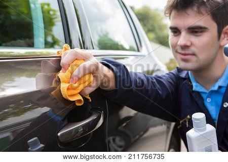 Man Polishing Car Door During Car Valet