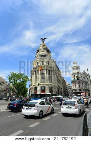 MADRID - JUN. 6, 2013: Metropolis Building (Edificio Metropolis) is one of the most famous Beaux-Arts landmark of Madrid. It located at the corner of the Calle de Alcala and Gran Via, Madrid, Spain.