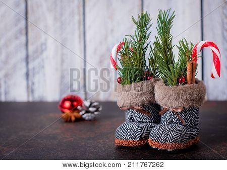 Christmas Boots Background. New Year Toy For Christmas Tree - Shoes Boots With Fir Branches, Cany Ca
