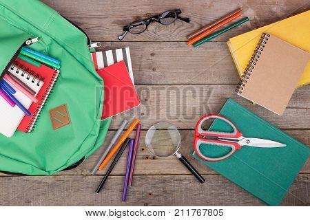Backpack And School Supplies: Books, Magnifying Glass, Notepad, Felt-tip Pens, Eyeglasses, Scissors