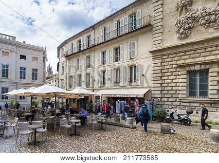 AVIGNON, FRANCE - APRIL 2, 2017: Outdoor cafe seating in Avignon, Southern France