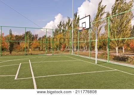 Sports Basketball Court Fenced With Mesh And Fence At The Base