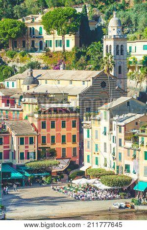 PORTOFINO, ITALY. October 20, 2017: Portofino in Italy. Colorful buildings, San Martin church and tourists. Piazza (Square) Martire dell'Olivetta.