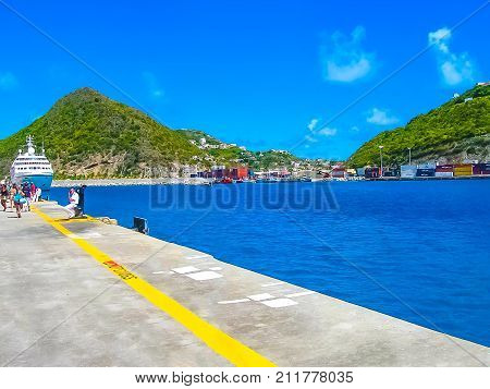Philipsburg, Sint Maarten - February 10, 2013: Tourists at Dr. Wathey Pier on the Dutch side of St. Maarten on February 10, 2013.