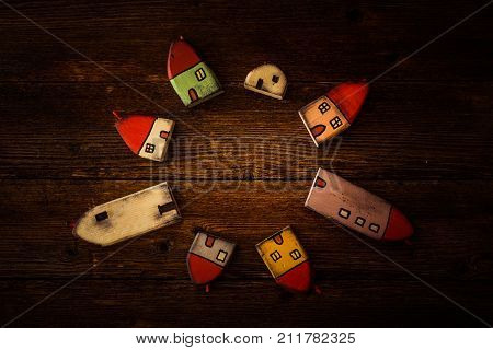 Fairytale Dwarf Houses On Wooden Background. Handmade Wooden Toys