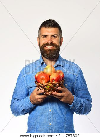 Farmer With Happy Face Holds Red Apples.