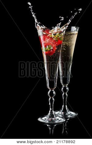 Two Glasses Of Sparkling Wine (champagne) With Splash And Strawberry